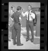 Police Chief Daryl F. Gates talking with officers in Los Angeles, Calif., 1988