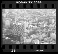 LAPD helicopter in-flight over downtown near One Wilshire building in Los Angeles, Calif., 1988