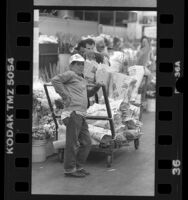 Lopez Gracino waiting with cart of flowers at Los Angeles Flower Mart, 1988