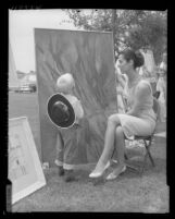Mike Molletta looks at painting by Bettina Brendel that took third place in show at the Downey Museum of Art, 1959
