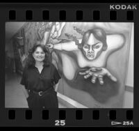 "Chicana artist, Judith Baca with mural ""Uprising of the Mujeres,"" Venice, Calif., 1988"