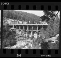 Crews reinforcing Big Bear Dam for mandated earthquake code, 1988