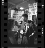 Ralph Nader talking with reporter during campaign for California Proposition 103, 1988