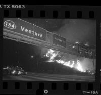 Night scene of wild fire burning along Ventura Freeway in Glendale, 1988
