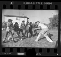 Former boxer Mando Ramos working with boys at Mahar House in Wilmington, Calif., 1988