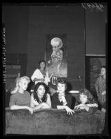 Posing before a sample of beatnik art are Miss Beatnik of 1959 contestants in Venice, Calif.