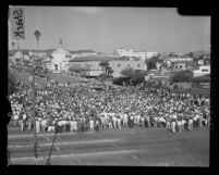 UCLA students in victory rally celebrating win over USC in football, 1959