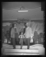 Don Phillips, John Wayne Wright and Paul Bradley model new fall fashions for men, Calif., 1948