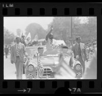 Mayor Tom Bradley waving to crowd during Fourth of July parade in Los Angeles, Calif., 1975