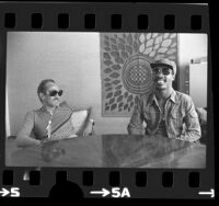Musician Stevie Wonder with music executive Ewart Abner in Los Angeles, Calif., 1975