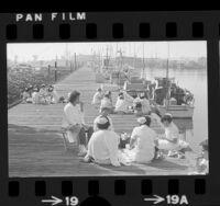 Women cannery workers taking lunch break on dock on Terminal Island, Calif., 1975
