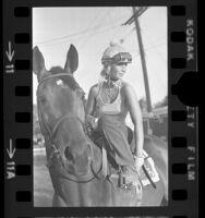 Jockey Mary Bacon training at Hollywood Park, Calif., 1975
