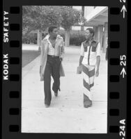 Two Fairfax High School students dressed in fashion of their day in Los Angeles, Calif., 1975