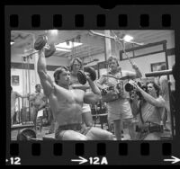 Documentary crew filming Arnold Schwarzenegger working out at Gold's Gym in Venice, Calif., 1975