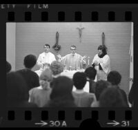 Cardinal Timothy Manning conducting Mass for inmates at Sybil Brand Institute for Women in Monterey Park, Calif., 1976