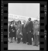 Tom Bradley and Israeli Prime Minister Yitzhak Rabin with their wives upon Rabin's arrival at airport in Los Angeles, Calif., 1976
