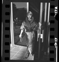Ad executive, Janet Carlson modeling sleeping bag coat in Los Angeles, Calif., 1976