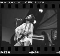 Cat Stevens (aka Yusuf Islam) performing on stage at the Inglewood Forum, Calif., 1976