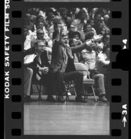 UCLA basketball coach Gene Bartow courtside during game in 1976