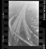 Aerial view of traffic on Santa Monica Freeway the day HOV lane started, Los Angeles, 1976
