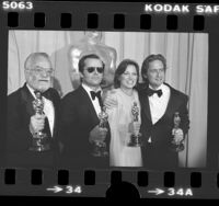 Saul Zaentz, Jack Nicholson, Louise Fletcher and Michael Douglas posing with their Oscars at the 1976 Academy Awards
