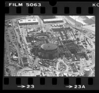 Aerial view of construction of San Onofre Nuclear Power Plant, Calif., 1976