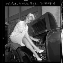 """Actress Carolyn Komant in public awareness role of """"Miss Safety Check"""" for the city of Burbank, Calif., 1961"""