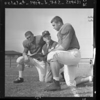 USC football coach John McKay with players Bill Nelson and Mike Bundra, 1961