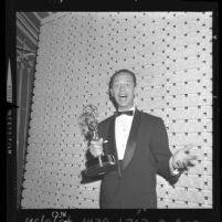 Don Knotts appears surprised as he receives award for Andy Griffith Show in Los Angeles, Calif., 1961