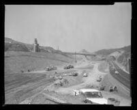 Grading work on section of San Diego Freeway running across Santa Monica Mountains, Calif., 1961