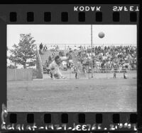 Mexican soccer goalie Luis Septien gets airborne during soccer match in Los Angeles, Calif., 1961