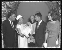 Peter and Pat Lawford with group outside of church after christening of their fourth child in Santa Monica, Calif., 1961