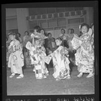 Japanese girls taking part in traditional Ondo dancing during Nisei Week festivities, Los Angeles, 1961