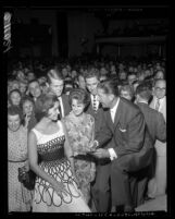 Lawrence Welk signing autographs during his appearance at the Hollywood Palladium in Hollywood, Calif., 1961