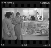 Dr. Joan Hodgman, Times Woman of the Year, talking with parents in neonatal unit, Los Angeles, Calif., 1976