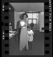 Athlete and Los Angeles Times Woman of the Year, Martha Rae Watson with her niece, Allyson, 1976