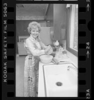 Actress Betty White preparing meal in Los Angeles, Calif., 1976