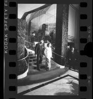 Betty Ford and Carey Grant descending staircase at Beverly Wilshire in Los Angeles, Calif., 1976