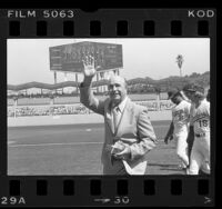 Los Angeles Dodgers' manager Walter Alston waving to fans during retirement ceremony at Dodgers' Stadium, Calif., 1976