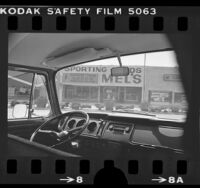 View from inside car of Mel's Sporting Goods where robbery involving Patty Hearst took place, Inglewood, Calif., 1976