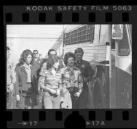 William and Emily Harris, manacled and being escorted to bus by sheriffs in Los Angeles, Calif., 1976