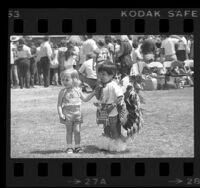 Two-year-olds, Michelle Bube, and Michael Ortiz at American Indian Scholarship Fund raising cookout in Los Angeles, Calif., 1976