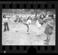 Five girls playing Chinese jump-rope at Elysian Park in Los Angeles, Calif., 1976