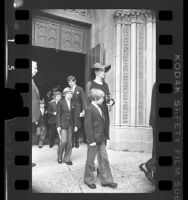 Gordon and Ann Getty with their four sons, leaving memorial service for J. Paul Getty in Los Angeles, Calif., 1976