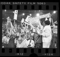 Michigan delegates waving Ford and Reagan placards during 1976 Republican National Convention in Kansas City, Missouri
