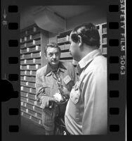 Police officer Robert Martinez returning stolen Oscar statue to costume designer, Bill Thomas in Los Angeles, Calif., 1976