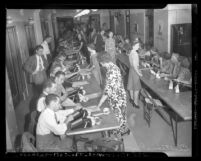 Rows of workers tabulating votes from Los Angeles, Calif. for 1942 California primary election, Los Angeles, 1942
