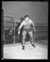Wrestler and football player Bronko Nagurski posing in ring, circa 1937