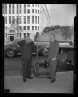 Los Angeles councilman J. Win Austin and mayor Fletcher Bowron testing an air raid siren in 1942