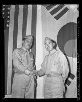 Yong Hak Park and Cheung Keun Lee, Korean American scout interpreters for U.S. Marines returning to Los Angeles, Calif. in 1943